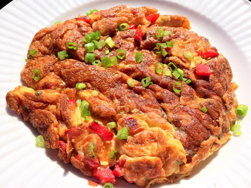food to Thai people. It is quick and easy. This golden brown omelet ...